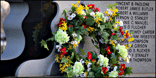 A wreath from the vigil adorns the memorial . . .