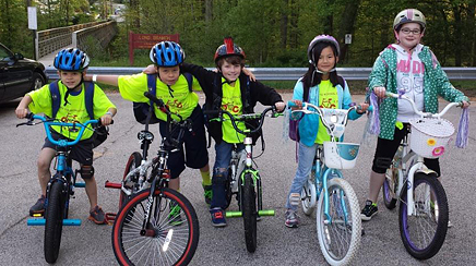 Students at Olde Creek Elementary School get ready for a bike train.