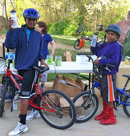 Thomas Harrison Middle School students receive water bottles for participating in Bike to School Day.