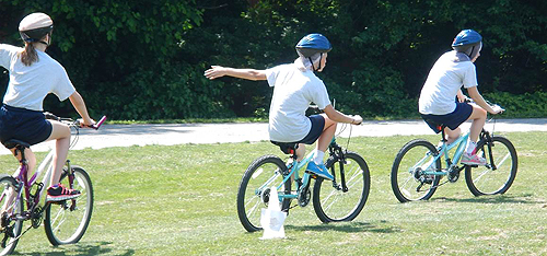 Students at Tuckahoe Middle School ride through a bicycle obstacle course during their Bike At School event.