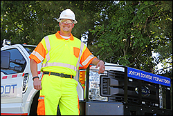 man in hard hat at safety service patrol truck